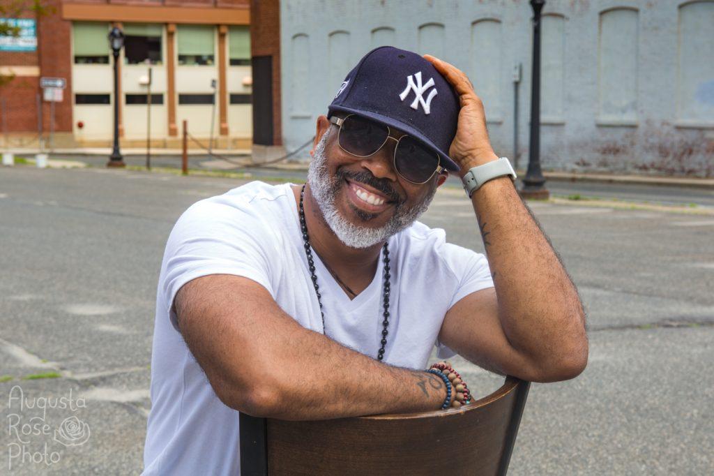 Ty Allan Jackson smiling wearing a New York Yankees hat